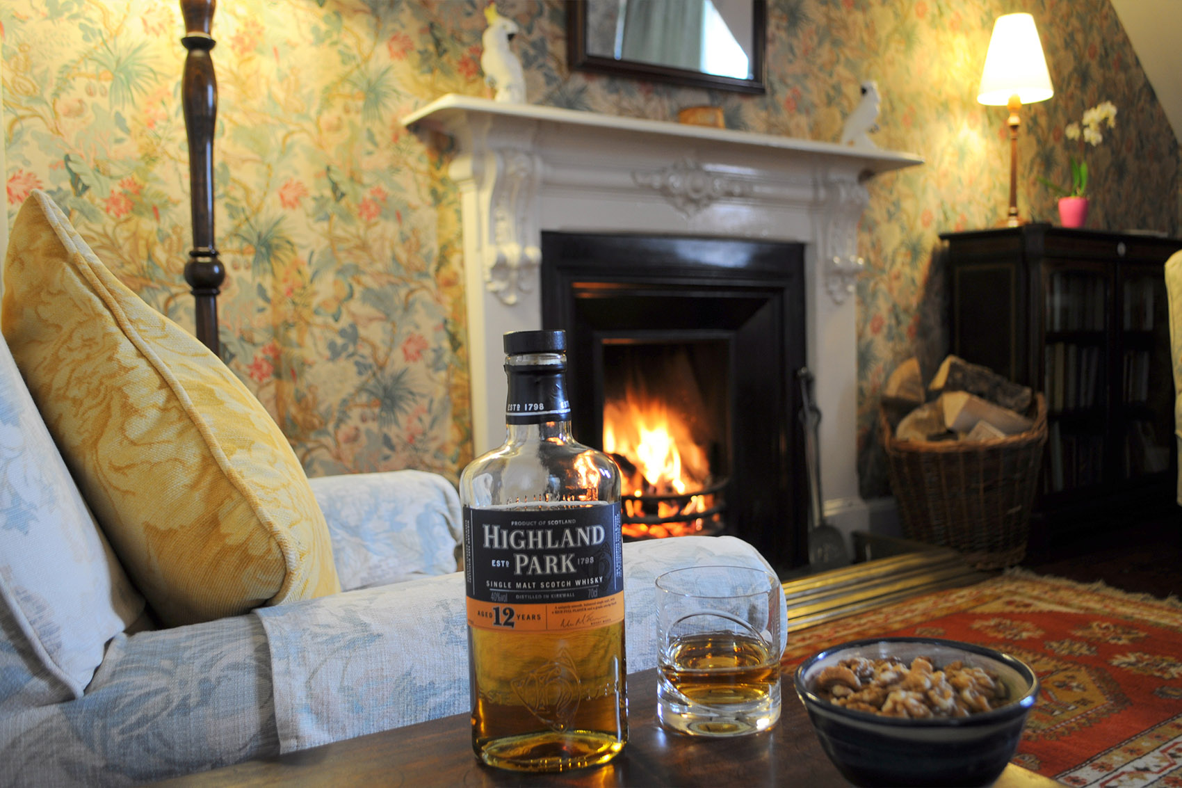 bottle of malt and fireplace
